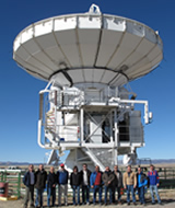 Some of the key people associated with the Greenland Telescope (GLT) project posting in front of the ALMA NA prototype antenna.The GLT project will retrofit and redeploy this antenna to Greenland. Several of the major antenna components require new design, revision, or retrofitting to survive the extreme cold environment, on the ice sheet of Greenland. This project, with the antenna located in US now and moved to Greenland later, posts some great challenge in management and technology that we have never faced before.