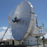 Retrofitting one of the ALMA prototype antennas for the use of VLBI in submillimeter wavelength. This picture shows the preliminary inspection of the antenna in July 2011, at the site of the Very Large Array near Socorro, New Mexico. This effort is led by ASIAA personnel, Philippe Raffin, Ted Huang, and Pierre Martin-Cocher, in collaboration with the engineers from Aeronautical Research Laboratory.
