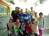 EA-FEIC staff members celebrating the delivery of the last receiver front-end system for our ALMA-Japan partner (blue cylinder-shaped object in the middle of the photo).
