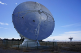 The ALMA-NA prototype telescope at Socorro, New Mexico, with one of the JVLA antennas.