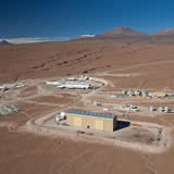To the right are the three antenna assembly sites belonging to the Japanese, North American and European partners; in the upper middle section is the operations building, and in the upper right, the road to the Chajnantor Plain.
