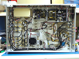 Photo of upgraded Correlator 1st Down Converter (C1DC) unit.  This upgrade consisted of increasing the intermediate frequency (IF) signal bandwidth from 4-6 GHz to 4-16 GHz while maintaining the current function of the existing legacy correlator.  The upgrade is visible as the rectangular metal plate near the bottom center of the photo.  The upgrade consisted of two wide-band amplifiers, power divider, and filter along with a cooling fan.