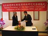 In September 2005, Academia Sinica (AS) signed an agreement with National Institutes of Natural Sciences of Japan (NINS) to join the ALMA-Japan project. AS President Yuan T. Lee shakes hands with Prof. M. Ishiguro, ALMA-Japan project director representing