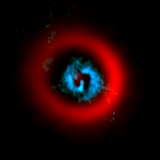 ALMA image of the dust ring (red) and gaseous spirals (blue) of the circumstellar disk AB Aurigae.